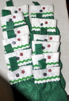 inspiration only/// mini stockings with mini dice charms sewn on