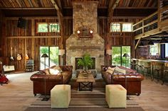 I love how open this is, the rustic interior, the balcony above the kitchen & the fireplace