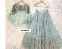 Stunning ice blue color designer lehenga and crop top with swirls. Lehenga and blouse with hand embroidery work. For your custom Mrunalini Rao . Indian Lehenga, Indian Gowns, Indian Attire, Pakistani Dresses, Indian Wear, Lehenga Choli, Lehenga Blouse, Sharara, Indian Wedding Outfits