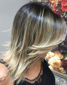 straight layered hairstyle with ombre highlights