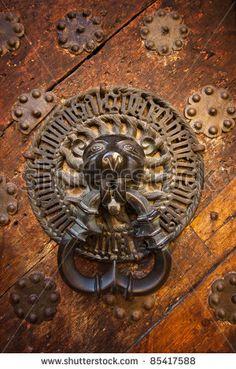 Ancient door knocker - stock photo