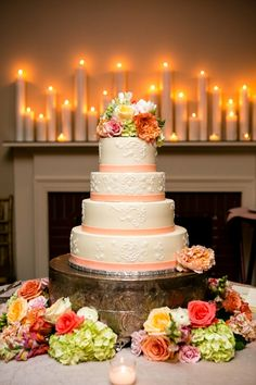 Vintage wedding cake- love the candles on the mantle behind!  // photo by The Collection
