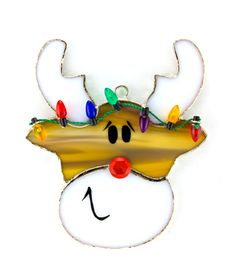 Adorable handmade reindeer stained glass night light cover and sun catcher.