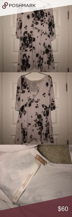 Free people tunic Black and white floral FP tunic!! Quarter length sleeves. Low cut in the back which is super cute! Can be worn as a dress or a longer shirt. Size small Free People Tops Tunics