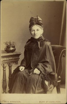 Studio portrait of a widow in half mourning with cloak and cap, by W S Spanton of Bury St Edmunds, 1880-90.