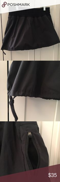 lululemon black bubble tennis skirt Cute lululemon black bubble tennis skirt with shorts/lining. Adjustable drawstring skirt bottom. Key pocket. Great condition! lululemon athletica Skirts