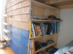 the bookcase opens to reveal the secret room. Little wheels at the bottom of the bookcase make it easy to pull it open.