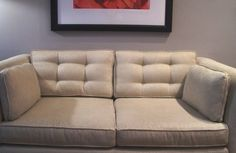 Perfect! A tutorial on how to tuft sofa back cushions for a more elegant look.