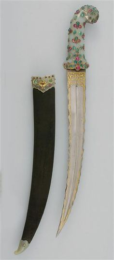 *INDIA~Edged weapon: Material+technique:Blade iron, forged,goldtauschiert;Handle,locket+chape nephrite, cut,inlaid w/emeralds+rubies,silver gilt frames; Wooden scabbard covered w/velvet;Cord w/an oval sapphire, emeralds+rubies.Numerous weapons captured from various battles of the Greek War of Independence found their way to Russia to Central Europe.Existed between Prussia+Russia...