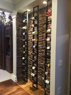 A wine cellar made up of VintageView wine racks on a floor t.- A wine cellar made up of VintageView wine racks on a floor to ceiling frame A wine cellar made up of VintageView wine racks on a floor to ceiling frame - Wine Cellar Basement, Wine Cellar Racks, Wine Rack Wall, Wine Wall, Metal Wine Racks, Cool Wine Racks, Glass Wine Cellar, Wine Rack Design, Wine Cellar Design