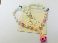 A personal favorite from my Etsy shop https://www.etsy.com/listing/246970742/lalalopsy-beaded-necklace-handmade-glass