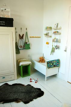 Sweet baby's room with storage ideas - small bathroom shelf racks for toys and simple hooks for bags