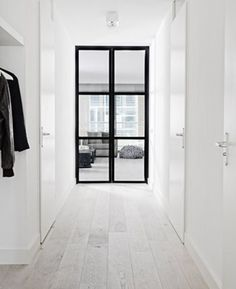 white timber flooring black window frames