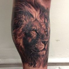Lion tattoo by Carlos Torres.