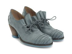 """The Mezzo Della is a granny-chic heel with a playful, vintage edge. This stellar shoe is built with inspiration from the beautiful interlacing of the well-loved Fluevog Family, The Operettas. The 2.25"""" heel is topped with soft, napa and matte leather, built into an easy, lace-up style. The Della is a fun little slip on heel that's as cute as it is comfortable."""