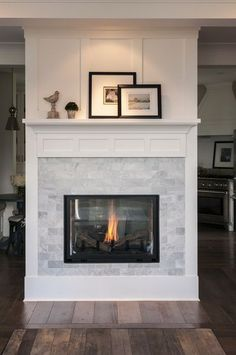 this fireplace boasts a marble subway tile surround for a formal elegant look this double sided fireplace fills the space with - Fireplace Surround Ideas