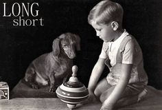 It's really all a little boy needs, his favorite spinning top and his beloved Dachshund.  vintage photo circa 1945