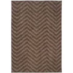 Update your current style with the Zigzag Rug. The bold pattern will superbly punch up your living space, while the neutral brown palette balances  the design with the rest of your décor.   Product: Rug  Construction Material: 100% Nylon  Color: Brown and tan      Features: Machine made    Woven    Made in the USA          Note: Please be aware that actual colors may vary from those shown on your screen. Accent rugs may also not show the entire pattern that the corresponding area rugs have.