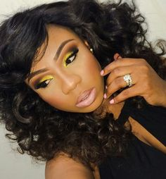Black & Yellow Smokey eyes w/ nude lips