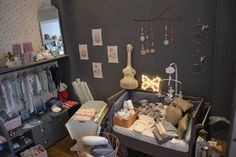 Ange Lapin mobile. Grey accent wall in the nursery. Kids shop display.