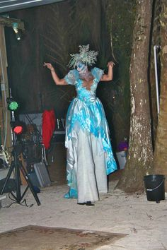 Ice Queen costume on stilts made from old wedding dress. kind looks strange here but the entire thing glows in the black light.