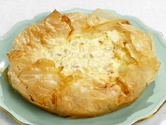 Easter Pie from FoodNetwork.com Recipe sounds like a custard combined with a rice pudding in phyllo