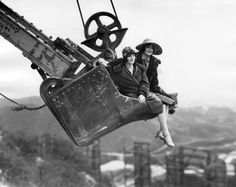vintage everyday: Two ladies are suspended high above the Hollywoodland sign as they ride on the shovel from Western Construction Co.'s working steam shovel in 1927