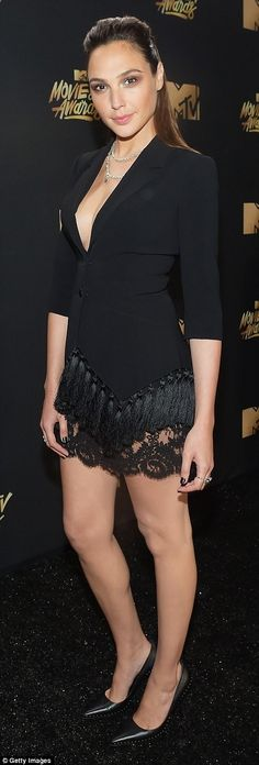 Classic in black! Actress Gal Gadot wore a tasseled frock, highlighting her sculpted legs;...