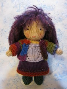 https://flic.kr/p/b5Dh3V | VioletDressed1 | A new doll for the New Year.  Violet is a knit Waldorf style doll.   Patterns for the doll and simple knit clothing are available free on my blog at:  www.byhookbyhand.blogspot.com  Happy New Year!  Violet is wearing undies, camisole, skirt and cardigan.