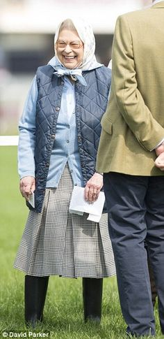 The Queen smiles in the sunshine as she enjoys a visit to Windsor Horse Show today