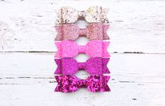 """Regular+price+-+$20 Handmade+2.25""""+glittery+bows+set+in+5+shades+of+pink,+and+on+your+choice+of+hair+clip+or+headband+style.+ Bows+are+made+from+a+canvas+style+woven+material+with+a+non+shed+glitter+coating+that+is+super+sparkly+in+the+sun.+ Get+these+bows+on+- ~Alligator+clips ~Snap+Clips ..."""