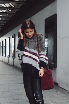 Comfy winter #outfit wearing striped sweater, leather pants, burgundy bag   #fashion #style
