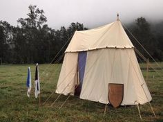 Double bell tent with cutting instructions.  Big enough for a double bed, small enough to fit in a hatchback.