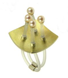 HIROKO YAMADA 'Popcorn Ring' in sterling silver, 18k yellow gold, rubber, and white pearls. Size is adjustable.
