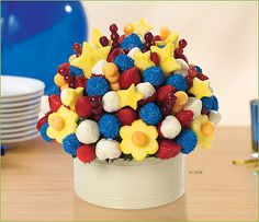 For any patriotic party this beautiful arrangement is the centerpiece, dessert and fireworks display all in one! Fresh red, white and blue strawberries - white chocolate dipped and blue sprinkle - are arranged with festive pineapple stars, grapes and cantaloupe to liven up any gathering with patriotic spirit. Available in 4 sizes #4th_of_july #memorial_day #ideas #gifts #holiday