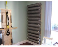 Foam roller/ yoga mat wood storage from AMAZON