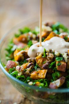 This Roasted Sweet Potato Salad has a handful of shredded kale, candied walnuts, and the best creamy almond dressing. Yum!