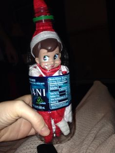 """So easy to do! Take the label off, use a knife and cut a little """"door"""" under where the label will be, shove him in, close the """"door"""" put the label back on. Christmas elf on a shelf in a bottle :) Christmas In July, Christmas Elf, Winter Christmas, Holiday Fun, Christmas Crafts, Christmas Ideas, Christmas Activities, Christmas Stuff, Christmas Ornaments"""