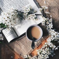 Coffee, flowers, and a book