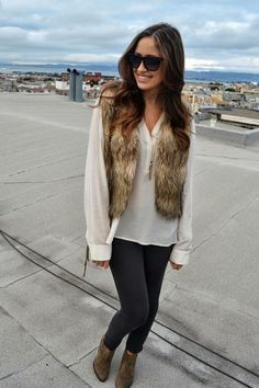 A cruelty free faux fur vest looks great with a long tailed soft blouse, leggings, and ankle boots