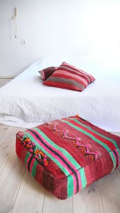 Moroccan kilim pouf - cover  Each of floor cushions cover is cut from an old carpet/kilim Moroccan and each one is unique.  Size 60 x 60 x 19 cm