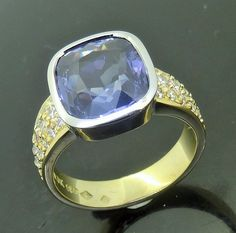 http://jewellerdirect.com.au/image/data/Gallery/Dress%20Rings/Synthetic-Sappjire-Diamond-Yellow-and-White-Gold-Ring-web.jpg