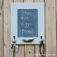 DIY Message Board and Organizer - A cabinet door is upcycled into a message board. Hooks organize keys, sunglasses, hats, dog leashes and anything else you need to keep handy. #diymessageboard #cabinetdoorupcycle #cabinetdoorchalkboard #upcycle