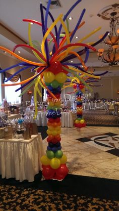 Rainbow Column.  I love the crazy top and they are easy to make for a ridiculously low price.  They do take time, but this is something I can prep a day or two before the event.  Maybe I will do two of these for on the floor flanking each side of the stage.  They scream fun!