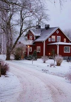 red house illuminated against a gray day