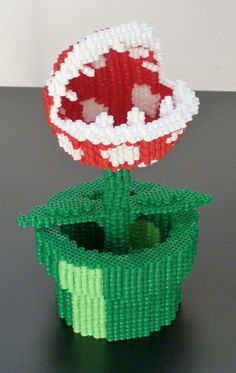 People do some crazy things with Perler beads these days! -- 3D pixelated carnivorous plant from Mario Bros.