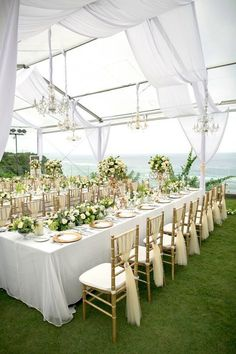 Elegant all white wedding decoration with a touch of golden tiffany chair | elegant wedding decor ideas | This is incredible! Unique work by  Flora Botanica Designs http://www.bridestory.com/flora-botanica-designs/projects/white-green-and-gold-elegant-wedding-at-latitude-villa