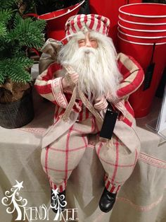http://www.trendytree.com/christmas-decorations/22-sitting-santa-red-and-natural-striped-clothing.html
