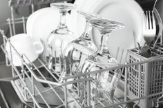 32791998 - open dishwasher with clean utensils in it
