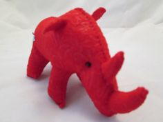 Red Rhino, red embossed felt, stitched in red, with a few black accents here and there...  RRRR is 8.5 from base of tail to the tip of his front horn. 4.5 inches from hump to hoof, and about 3.5 wide. Measurements vary, each Critter is a ooak, not any of them are exactly the same. That's what gives them their personality.  Cosmos Critters, if bought for a child are toys to be played with gently. Please know that small beads or buttons are used for the eyes. Please make a note when purchasing…